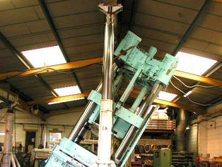 Hydraulic gantry tilting a press for installation